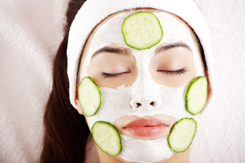 Woman with cucumber slices on the face